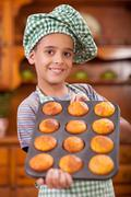 Young boy chief  showing his made corn bread Stock Photos