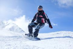 Snowboarder in action at the mountains Stock Photos