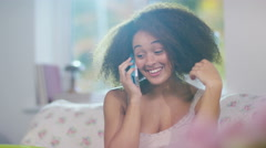 4K Young girl talking on mobile phone at home Stock Footage