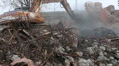 Big excavator rake ruins of an old building. - stock footage