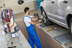car mechanic stop terminate on sensor - stock photo