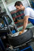 Engineer diagnostics tyre - stock photo