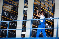 Auto Auto mechanic pushes the car tire - stock photo