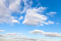 stratus clouds in blue sky in autumn sunny day - stock photo