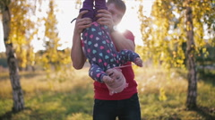 The father hung the child's legs, then put on the ground. Stock Footage