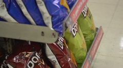 Stock Video Footage of Unhealthy Groceries in Convenience store aisle - Corner Store