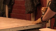 Woodworker Smoothing Wood With An Electric Planer Stock Footage