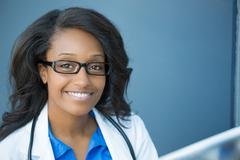 Closeup headshot portrait of friendly, smiling confident female healthcare pr - stock photo