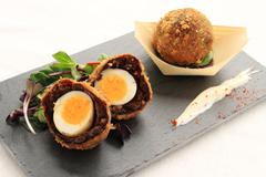 Scotch eggs appetizer Stock Photos