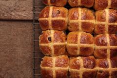 fresh baked hot cross bread buns - stock photo