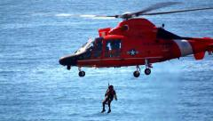 US Coast Guard Helicopter Performing Rescue Mission - stock footage