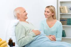 Nice pleasant conversation of two relatives at hospital - stock photo