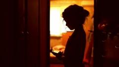 girl teen looking smartphone game on Internet indoor in corridor  yellow brown - stock footage