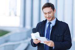 Journalist is reading his current strategy written in notepad Stock Photos