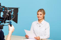 Agreeable TV announcer being involved in work - stock photo