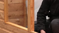 A Carpenter Fix Nails With His Hammer Stock Footage
