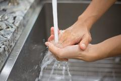 Closeup portrait, hand washing technique. Keeping hands free of dirty virus b - stock photo