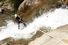 Waterfall Rappelling On Canyoning Adventure - stock photo