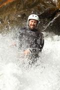 Stock Photo of Extreme Canyoning Waterfall Fun