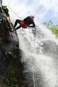 Stock Photo of Waterfall Rappelling On Canyoning Adventure