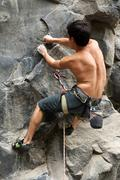 Stock Photo of Courageous Rock Climber Aerial Shot