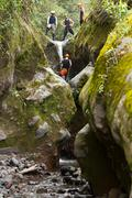 Group Of Adult Men On Canyoning Trip - stock photo
