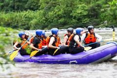 Whitewater River Rafting Boat With Tourists Stock Photos