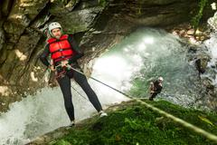 Team Of Mixed People On Canyoning Adventure - stock photo