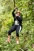 Scared Oversized Adult Woman On Zip Line - stock photo