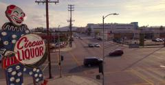 Aerial view iconic 32-ft. neon clown sign at Circus Liquor store North Hollywood - stock footage