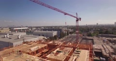 Aerial view crane building construction site city Los Angeles skyline Stock Footage