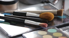 Make-up brushes and cosmetic palette Stock Footage