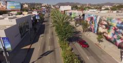 Low altitude aerial view of Highland Avenue near Santa Monica Blvd in Hollywood Stock Footage