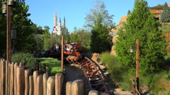 "People ride on the New Ride ""Seven Dwarfs Mine Train"" Stock Footage"