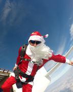 Skinny Santa jumping from the plane Stock Photos