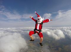 Santa jumping with parachute Kuvituskuvat