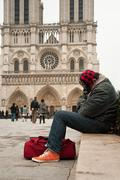 poor man to Notre-Dame of Paris - stock photo