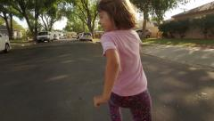 Happy 5 year old girl child running away from POV camera. Slow motion. Stock Footage