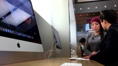 People buying new iMac inside Apple store in Coquitlam BC Canada Stock Footage