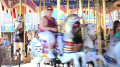People ride on a traditional carousel Stock Footage