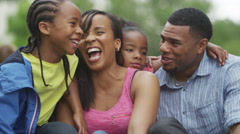 4K Portrait of attractive smiling African American family having fun in the park Arkistovideo