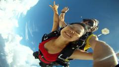 Skydiving tandem jump Asian girl Stock Footage