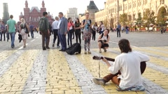 A street musician plays guitar on the square Stock Footage