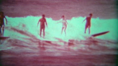 1966: Hawaiian longboard surfers share a big ocean wave. - stock footage