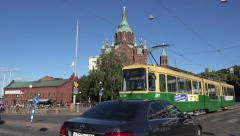An electric tram (in 4k) and Uspenski Cathedral, Helsinki, Finland. Stock Footage