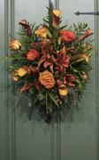 Autumn floral, flower wreath arrangement on door - stock photo