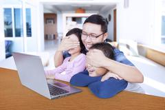 Father prevents his children watching adult content - stock photo