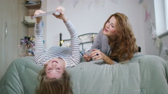 4K Young female friends in bedroom using technology Stock Footage