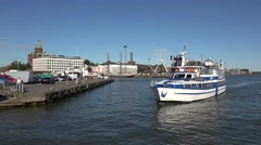 A tourist harbour cruise boat (in 4k) in Helsinki harbour, Finland. Stock Footage