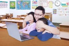 Teacher prohibits his students watching adult content - stock photo